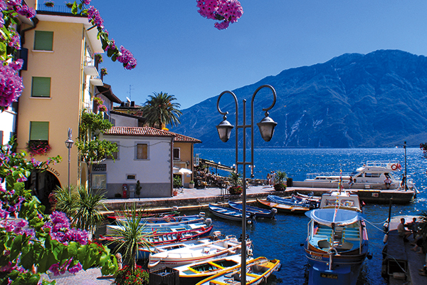 View of boats and buildings in Limone on Lake Garda, Italy