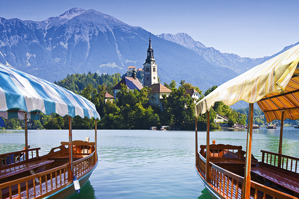 Plenta boats and island church on Lake Bled in Slovenia