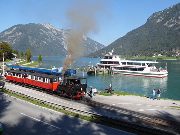 steam train by a lake