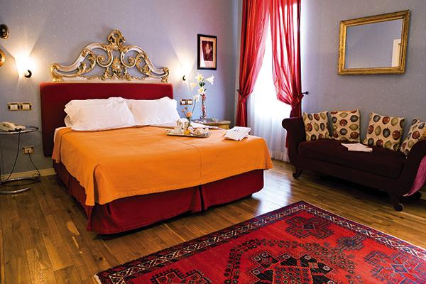Bedroom at the Hotel Regina Adelaide in Garda, Italy
