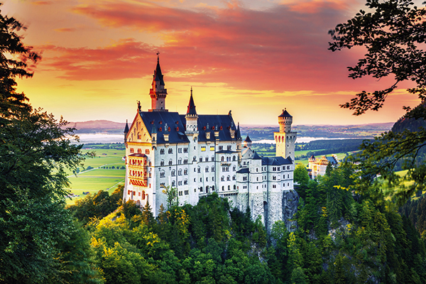 Sunset view of Neuschwanstein Castle in Germany from Mary's Bridge