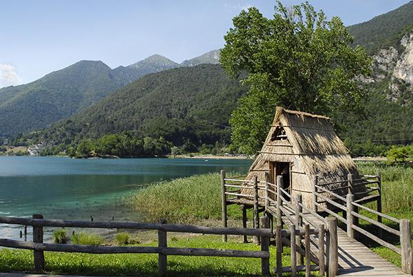 Stilt house next to lake